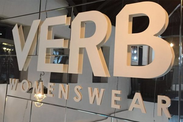verb womenswear acrylic signage